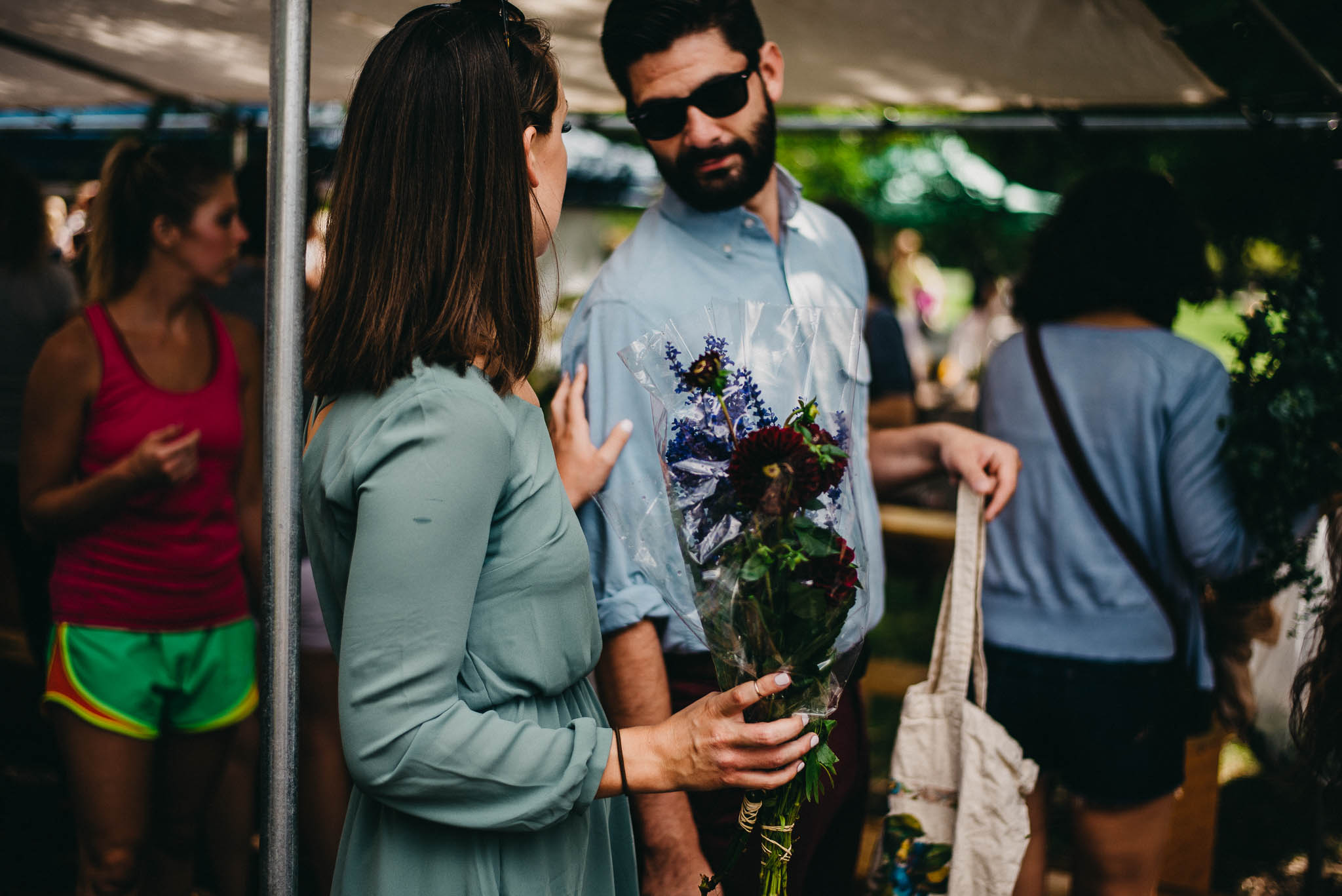 Couple buying flowers from a Chicago farmers market