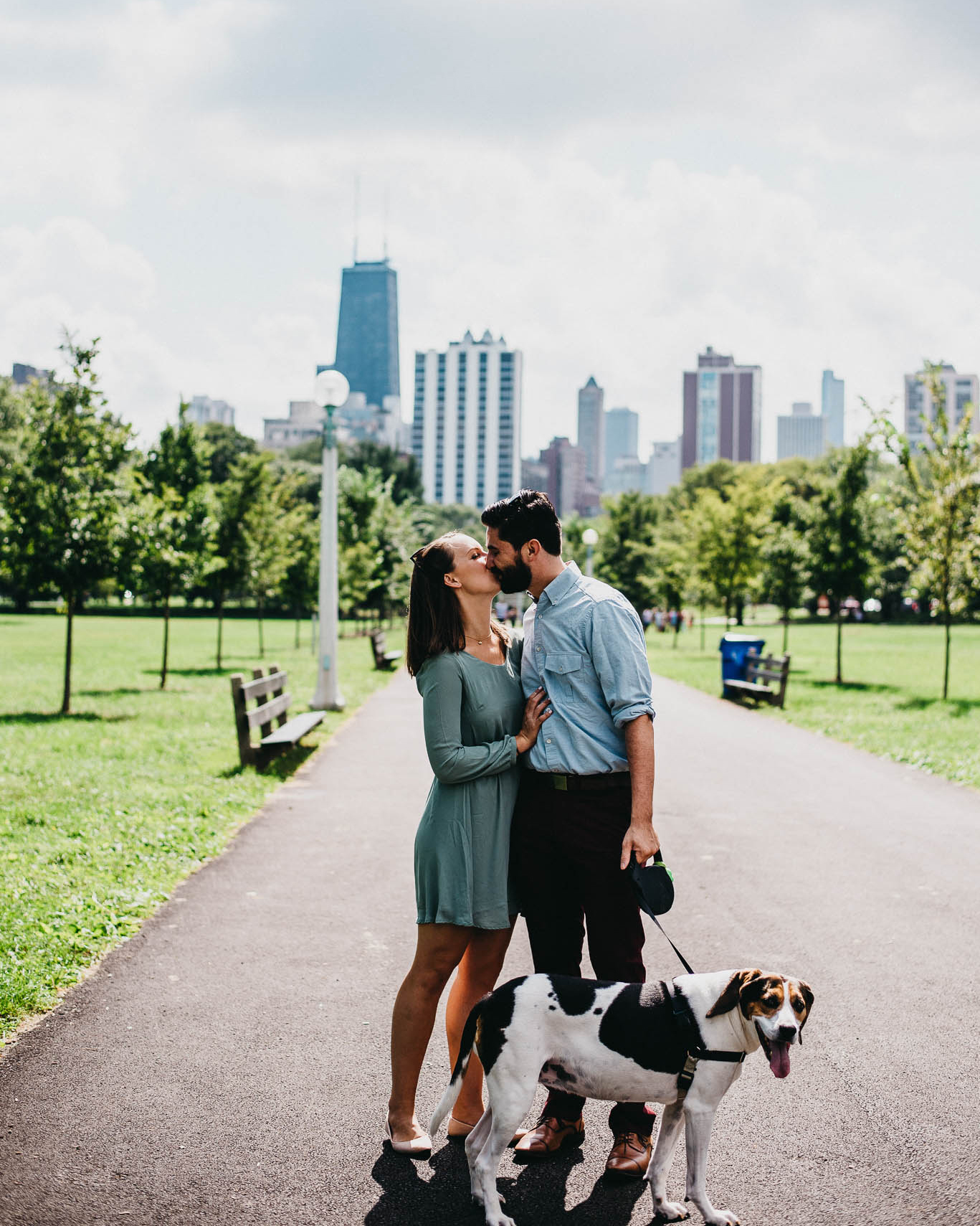 An engaged couple kissing in a Chicago park