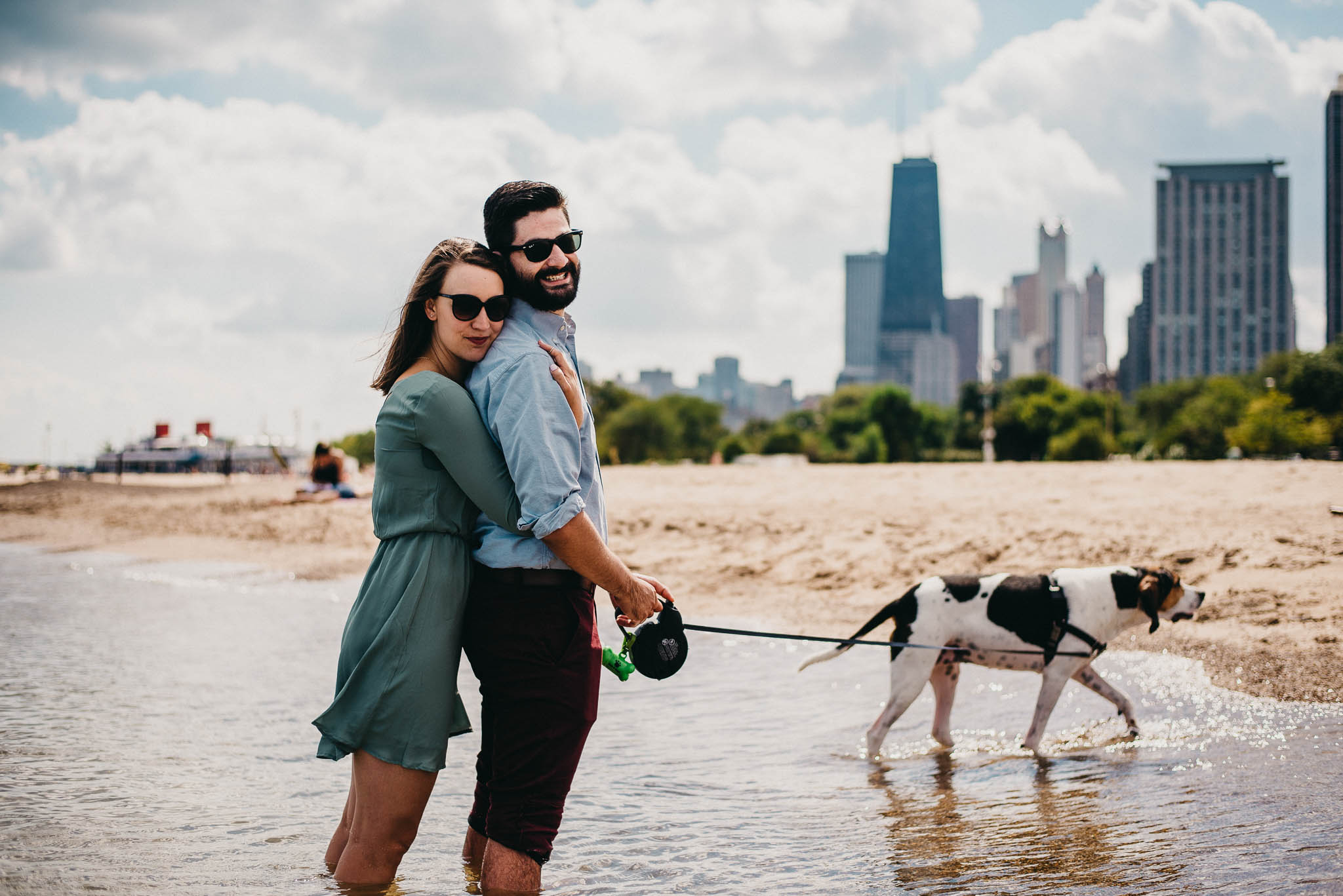 A couple dipping their feet in Lake Michigan