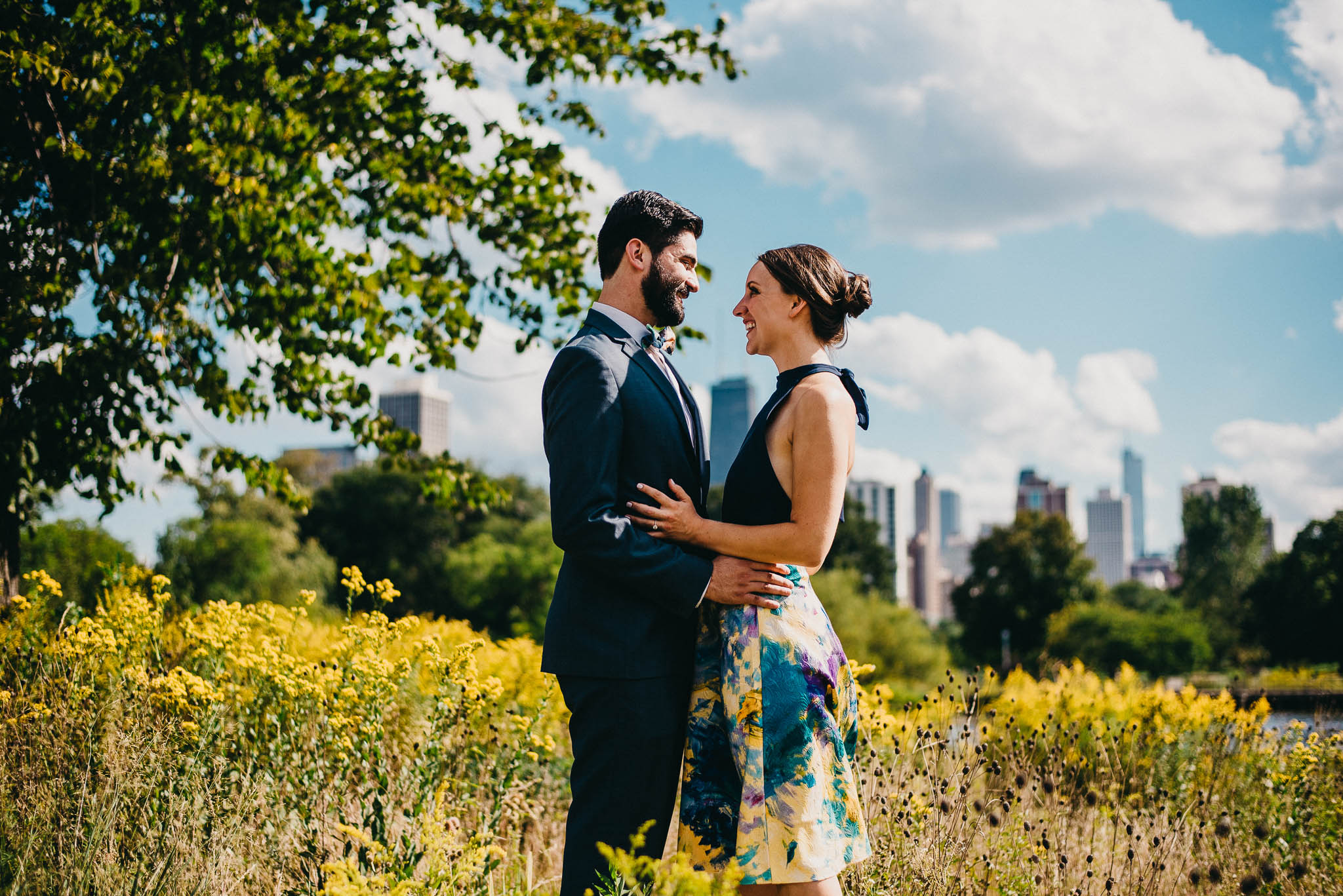 engaged couple posing in a Chicago park