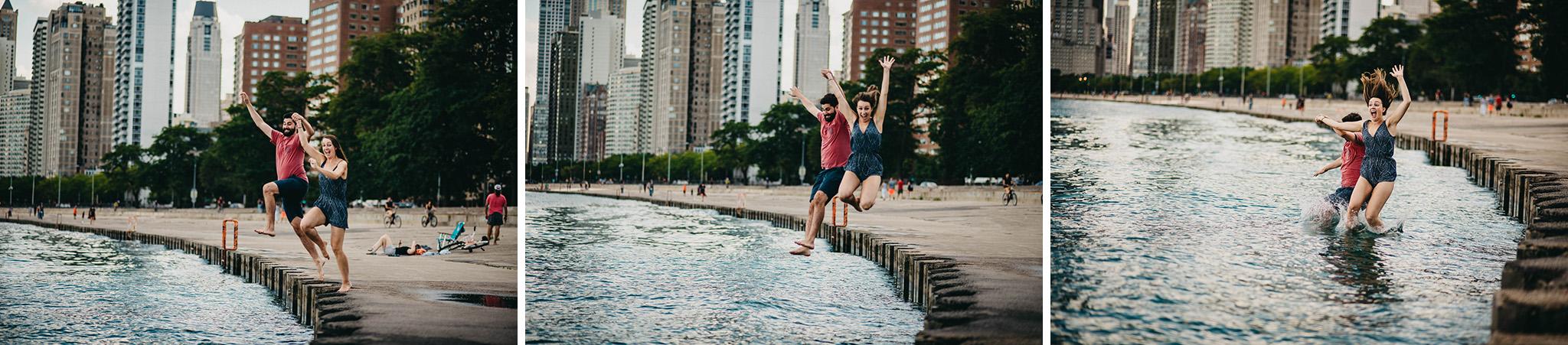 Engagement photo of couple jumping into lake Michigan