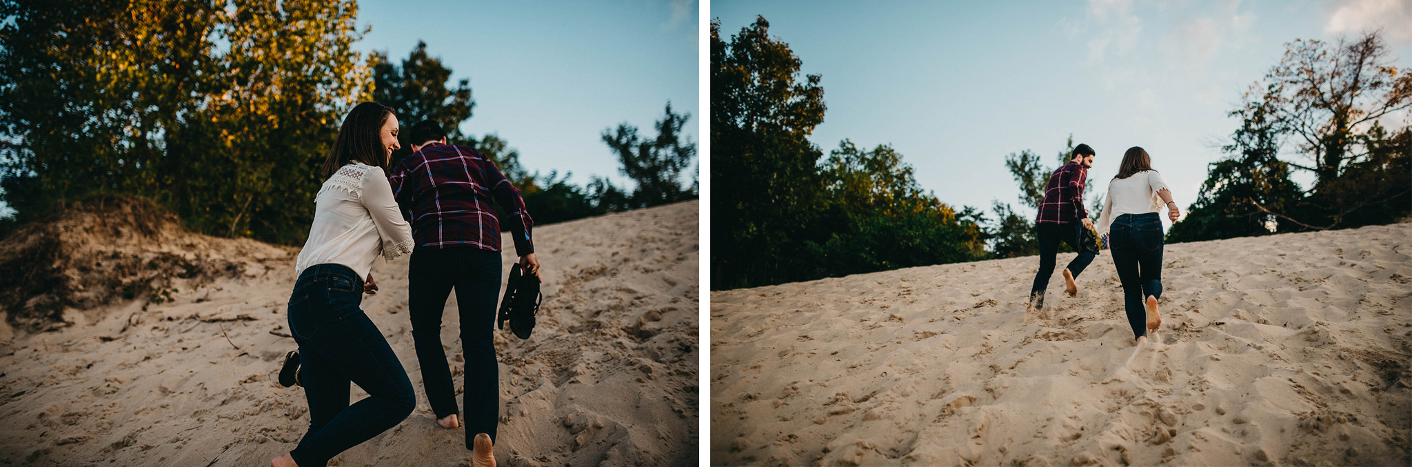 Engagement photo of couple racing up a sand dune