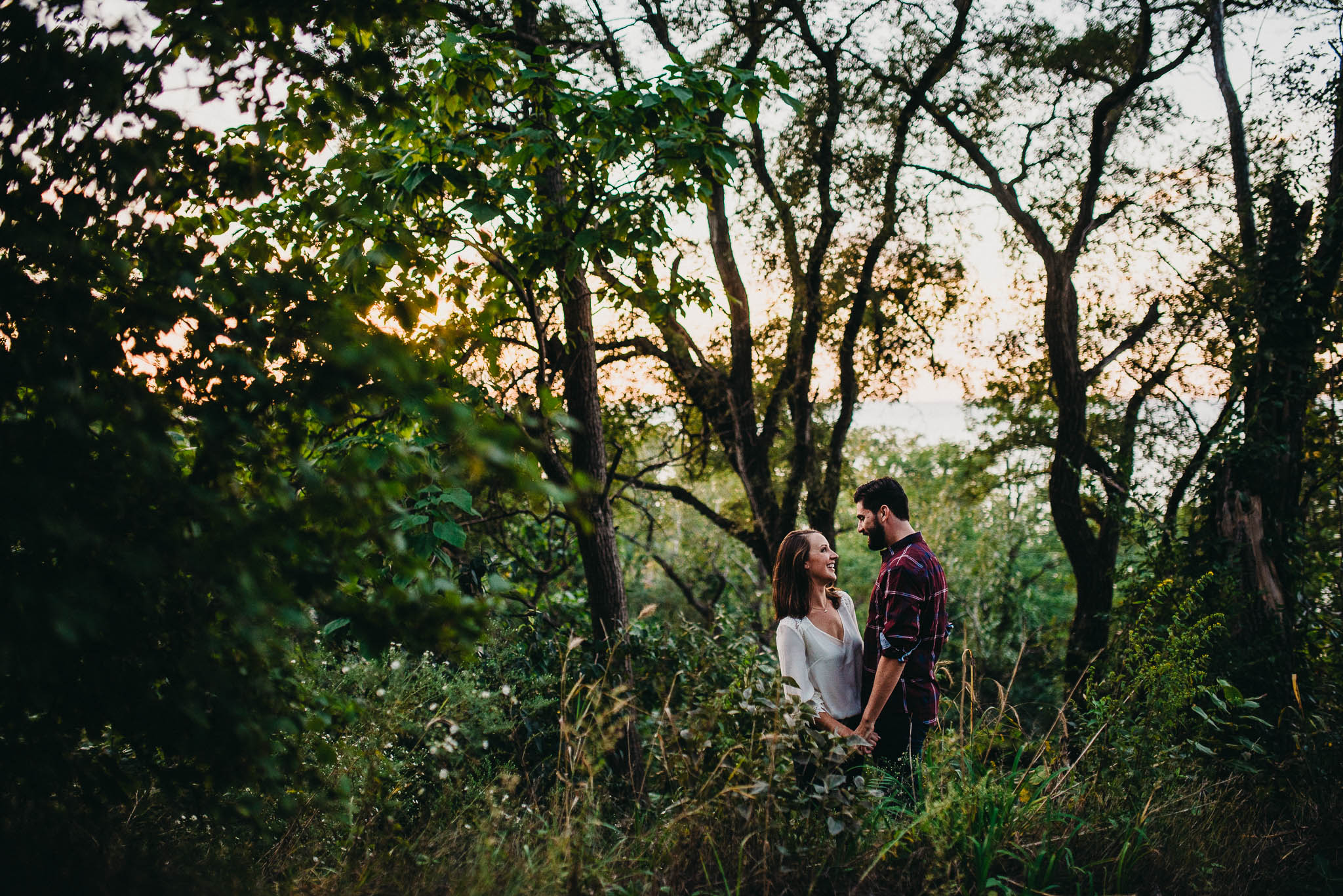 couple standing in forest near lake Michigan