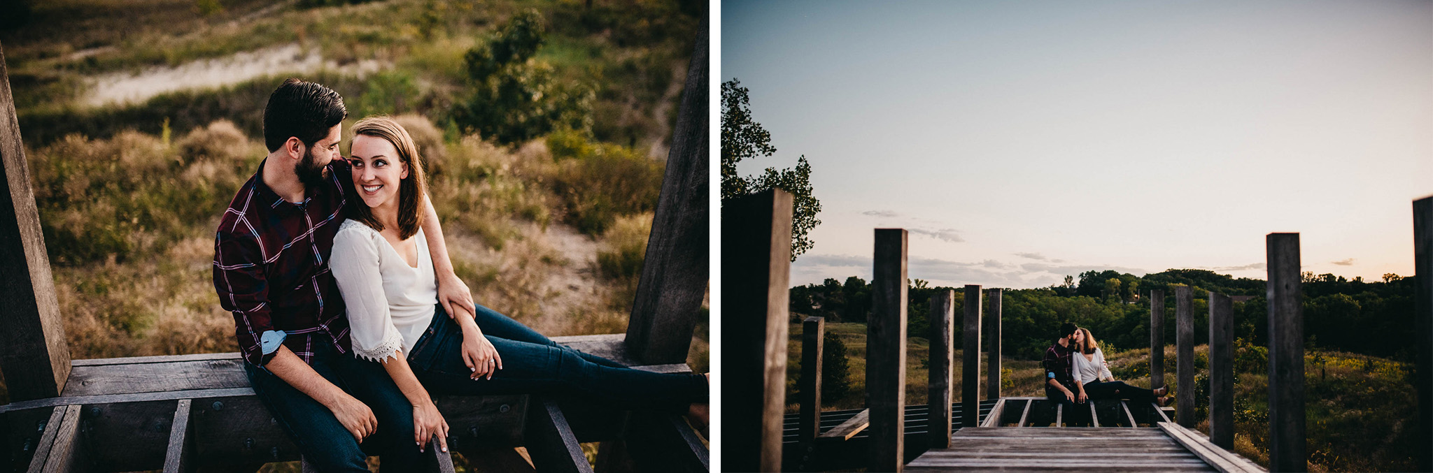 engagement photo of a couple sitting on an unfinished board walk at the top of a sand dune