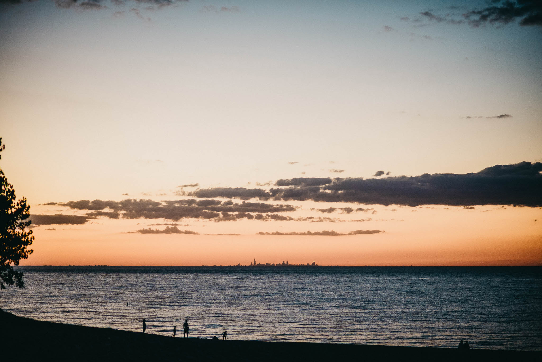 The Chicago city skyline at sunset seen from the southern shores of Lake Michigan