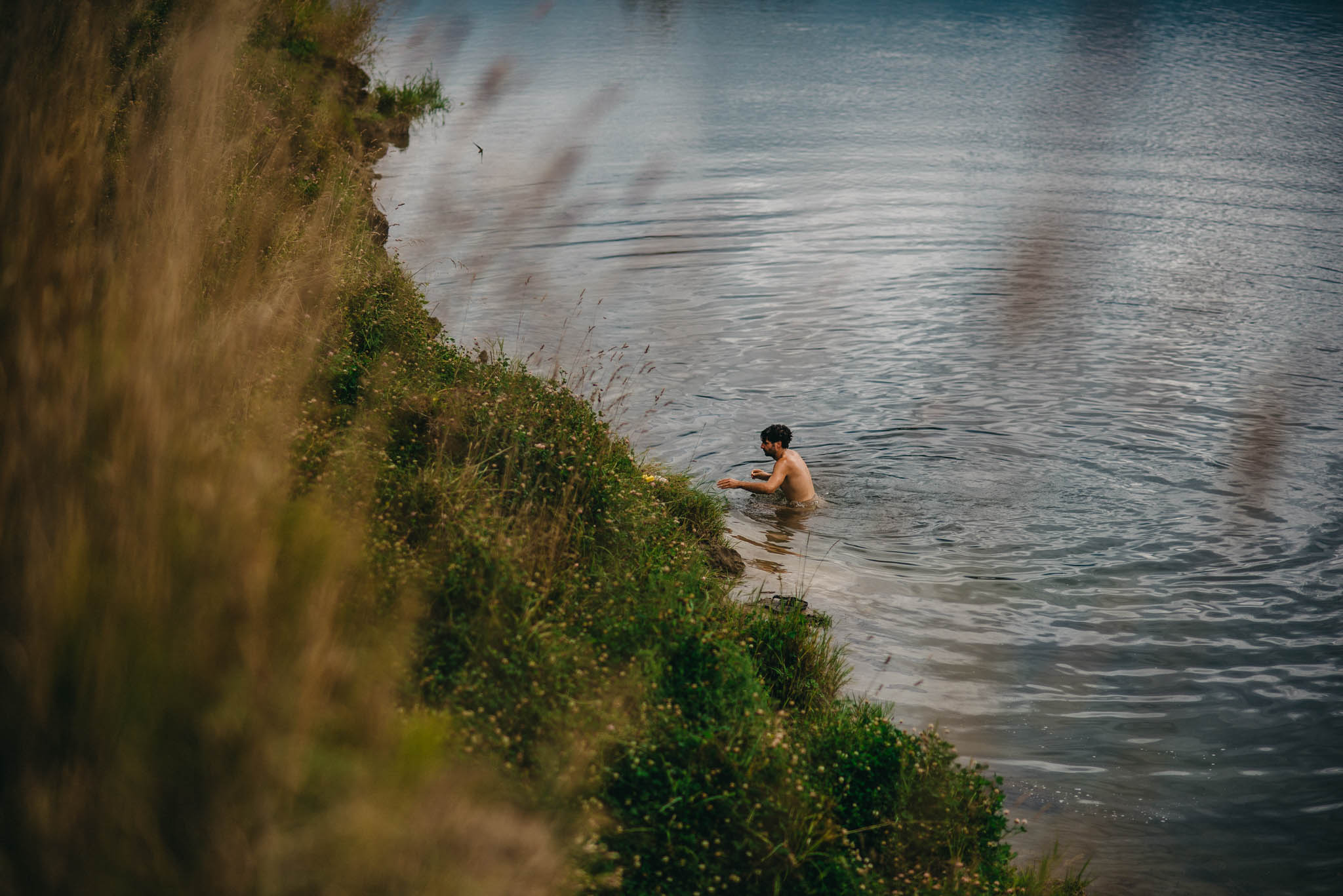 groom swimming in river