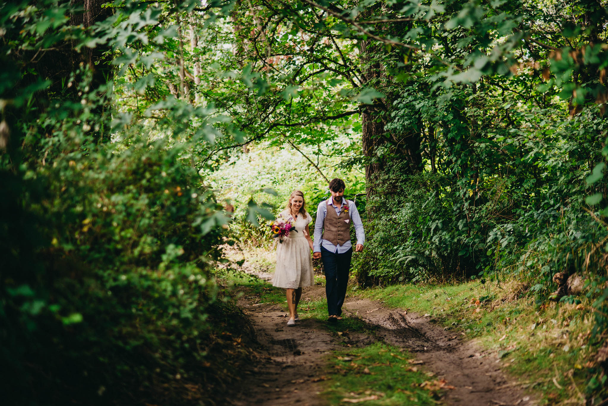 bride and groom walking to wedding ceremony