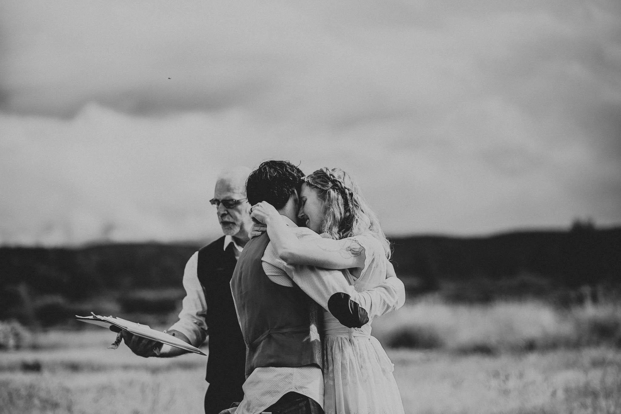 bride and groom hug during wedding ceremony
