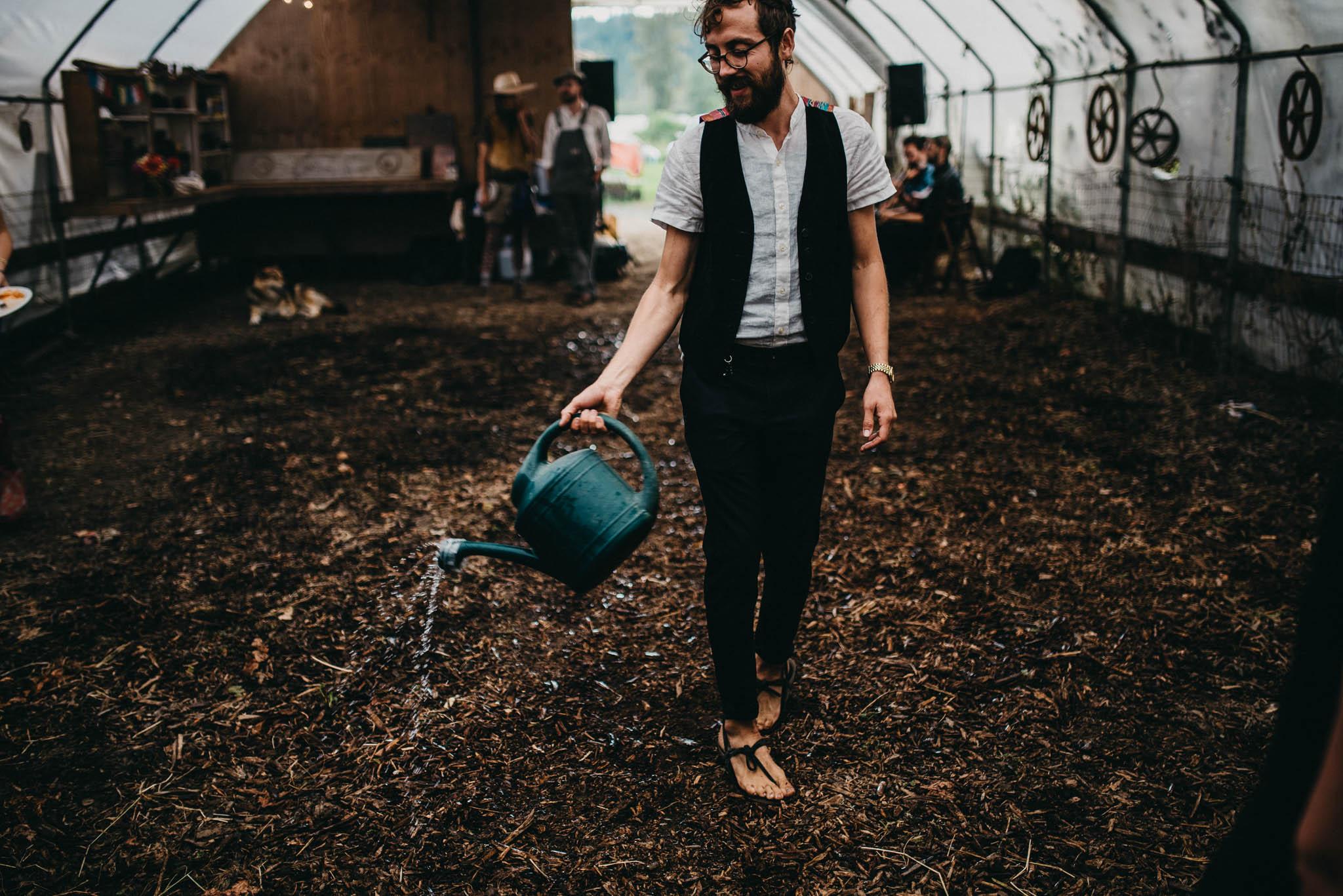 preparing dirt dance floor at farm wedding