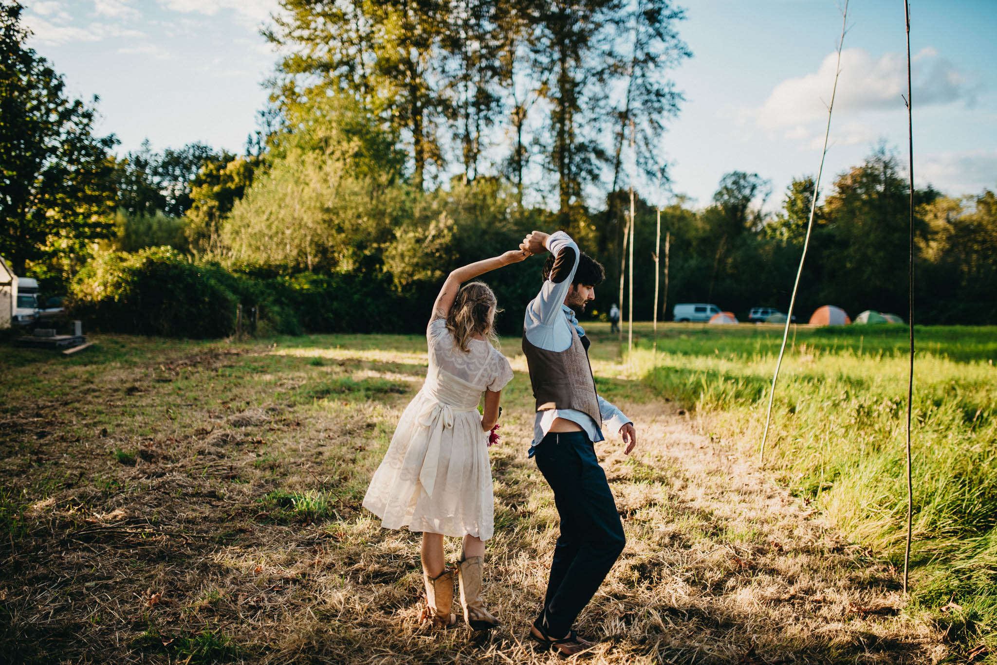 bride and groom dancing at farm wedding