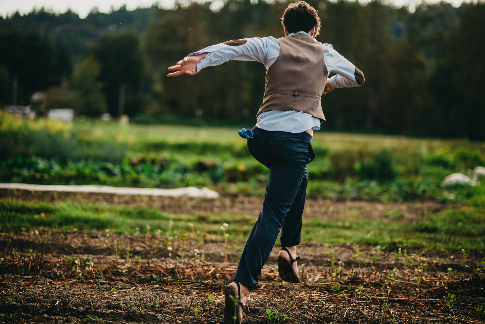groom running through farm field