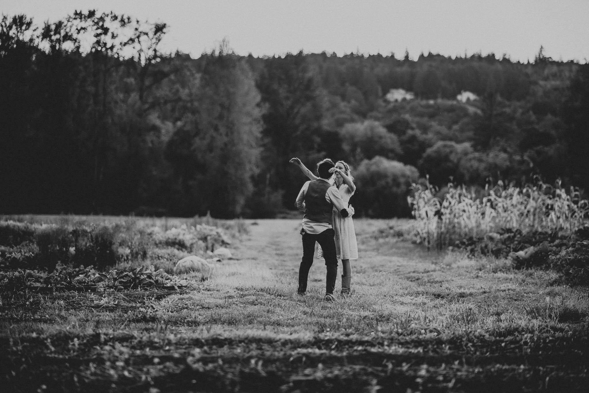 bride and groom hugging at farm wedding
