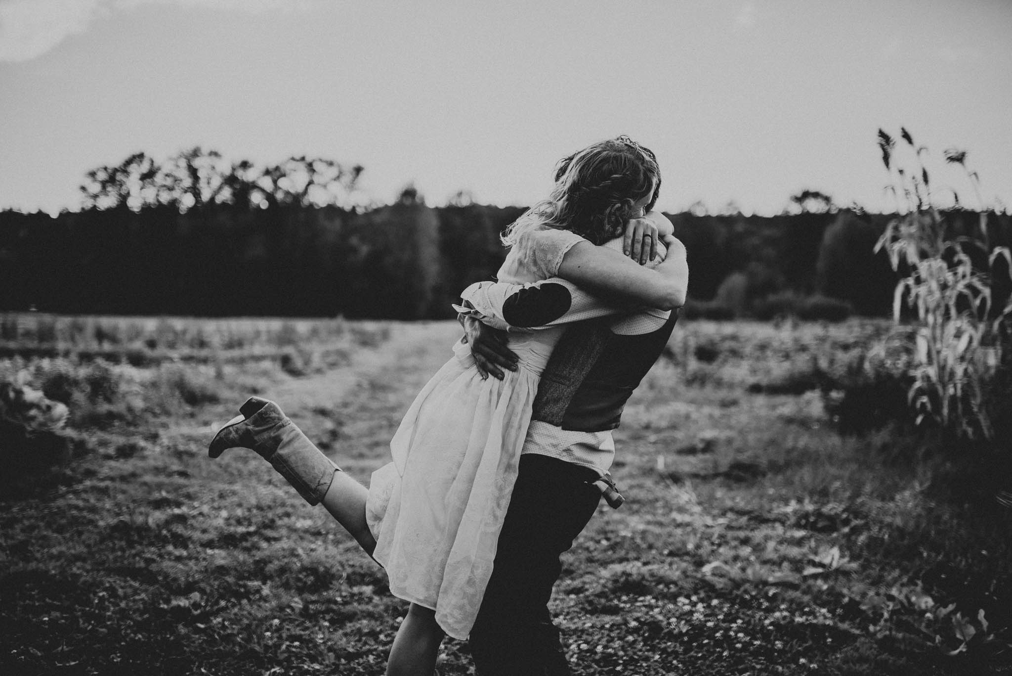 bride and groom hugging during sunset