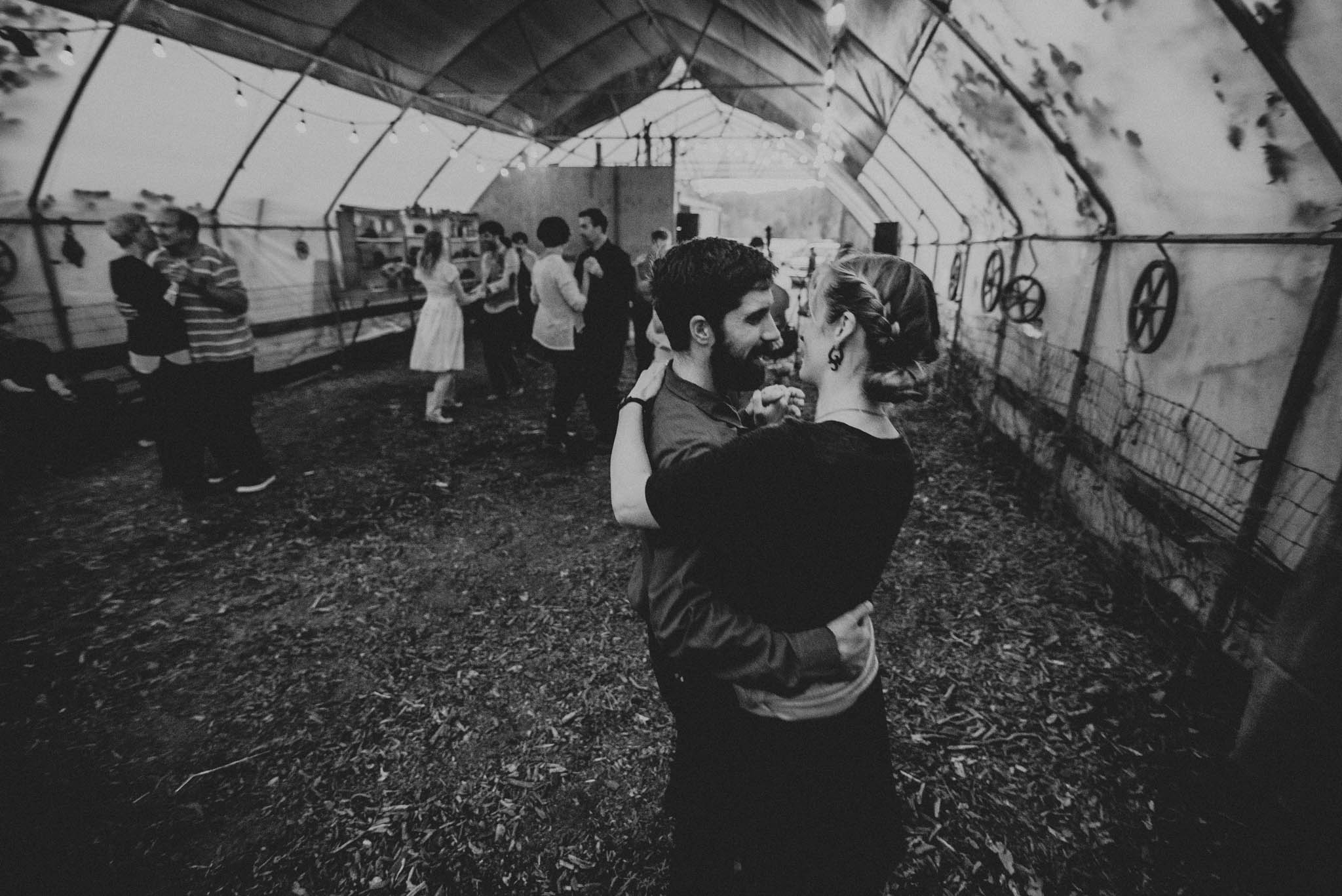 guests slow dancing at farm wedding